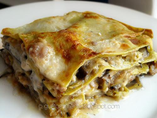 Lasagne di spinaci con melanzane grigliate, salsiccia e formaggio bitto