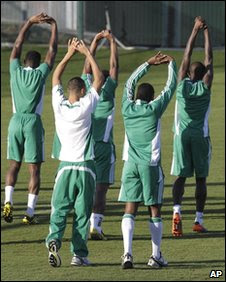 Nigera squad warms up before a training session
