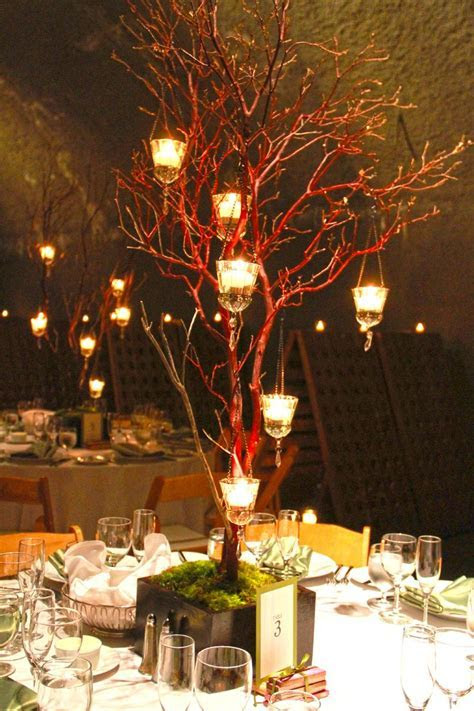 Manzanita Branches with hanging candles and moss base in