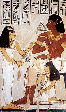 Meryt, the wife of Sennefer, presents him with lotus flowers (from a tomb depiction)