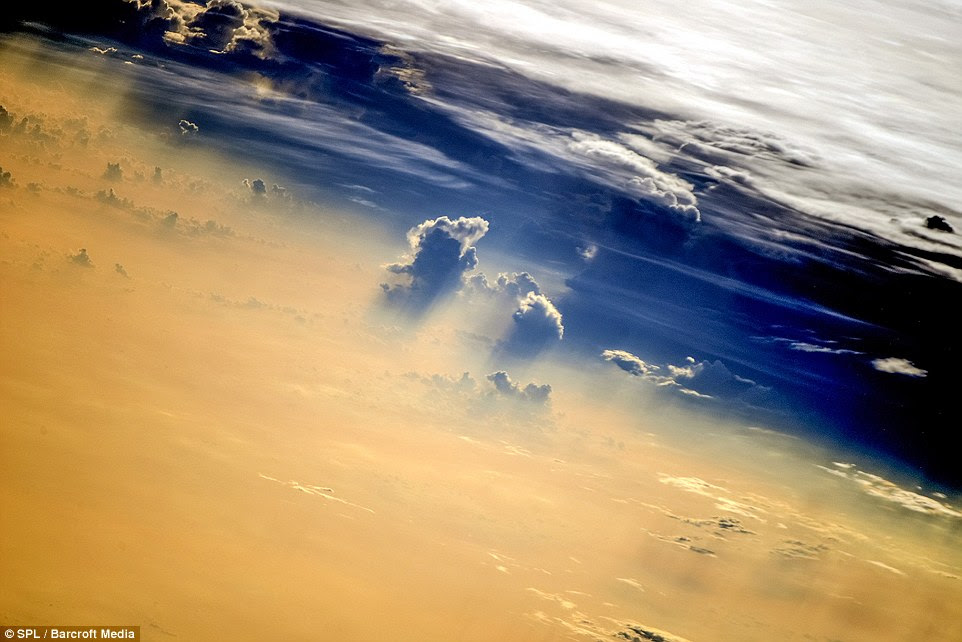Covered: Shown here is a beautiful view of clouds over Earth taken in August by astronauts living on board the International Space Station