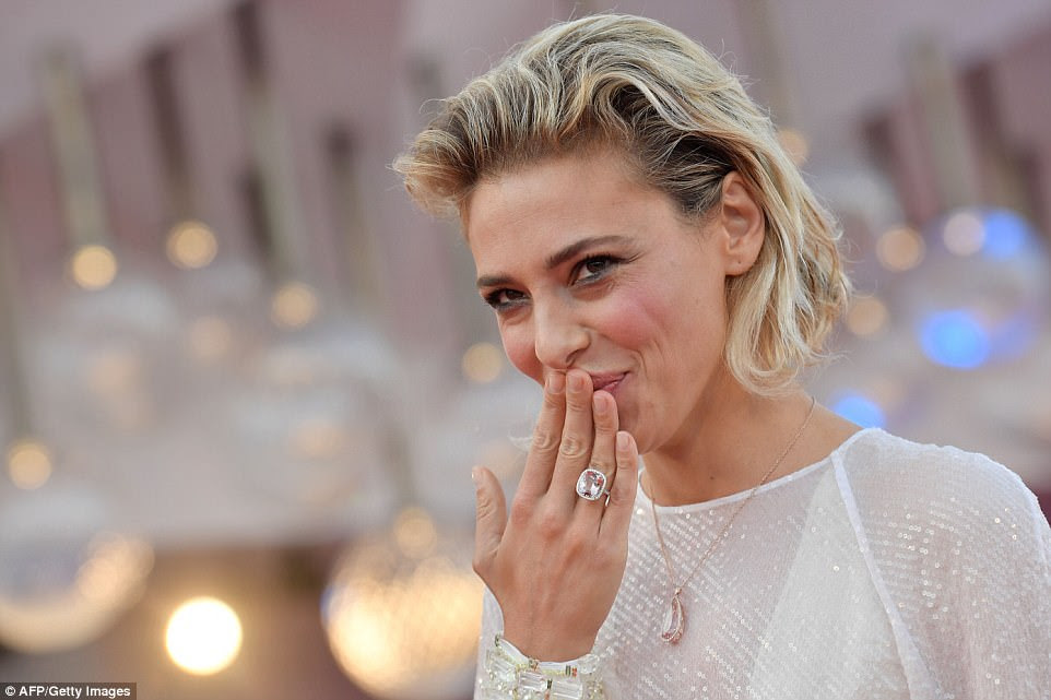 Showing the love: She showed off a large ring as she blew kisses to onlookers