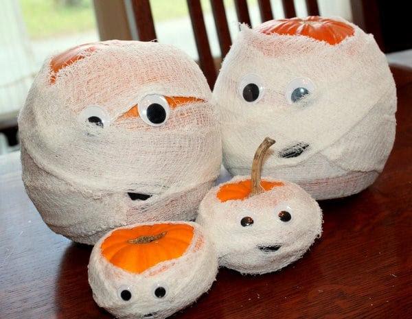 Make a family of pumpkin mummies for Halloween