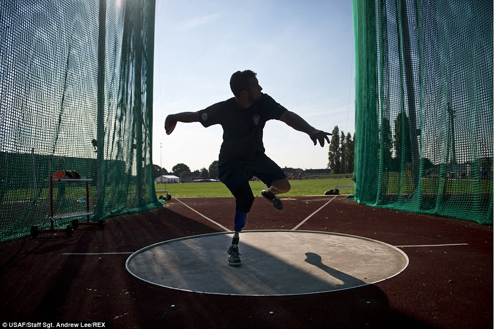Invictus: Max Rohn, a retired Navy 3rd Class Petty Officer, winds up to throw a discus during training for the Invictus Games at Mayesbrook Field in London. The Invictus Games is an international Paralympic-style, multi-sport event designed for wounded service members