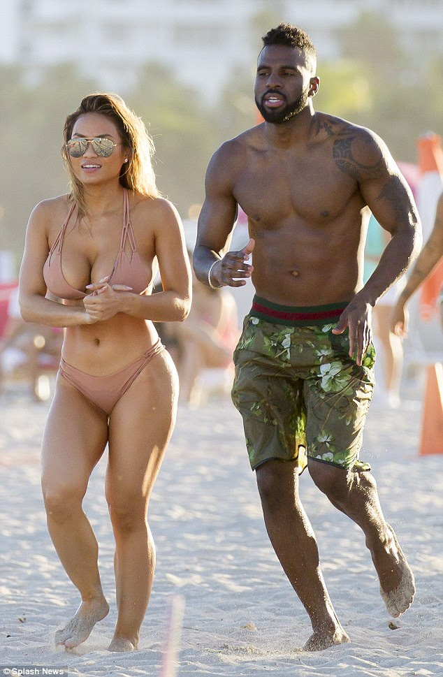 Red hot romance: Jason Derulo was spotted enjoying day of fun in the sun with new girlfriend Daphne Joy at Miami Beach on Friday