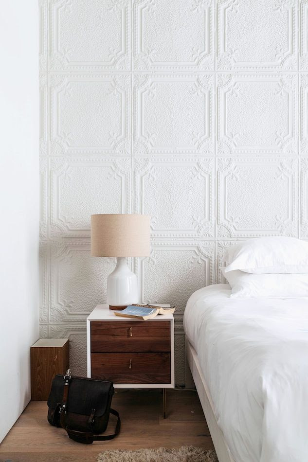 Le Fashion Blog A Fashionable Home Neutral Chic Bedroom New York City Textured Wallpaper Mid Century Contrast Nightstand Via One Fine Stay