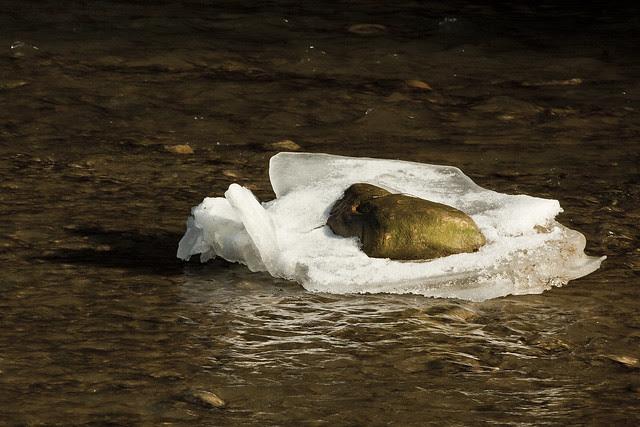 golden rocks on ice
