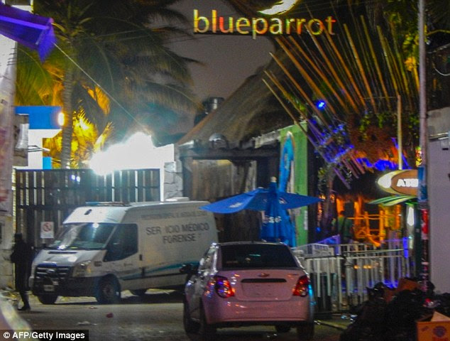 A Forensic Medical Service van is parked outside a nightclub in Playa del Carmen following the shooting