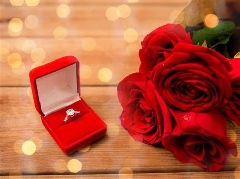 A Wedding Ring And A Bouquet Of Red Roses Widescreen Free