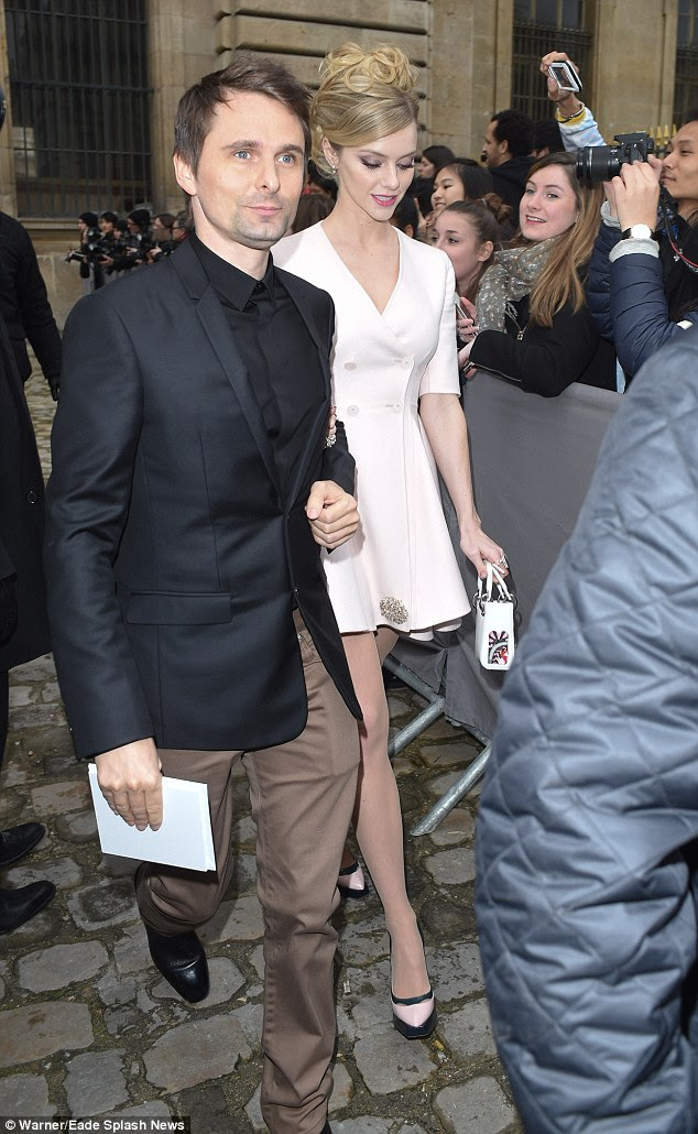 Head down: She followed him out of the venue, and towered over him in her heels