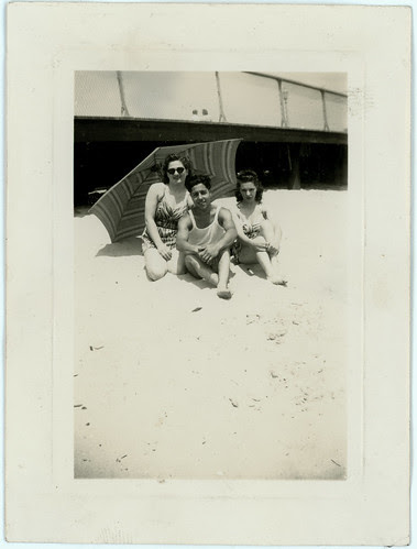 Man, two women on beach