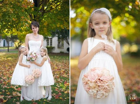 bride and flower girl's pose, flowergirl holding peach