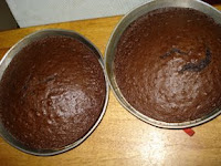two 9x9 chocolate cakes cooling