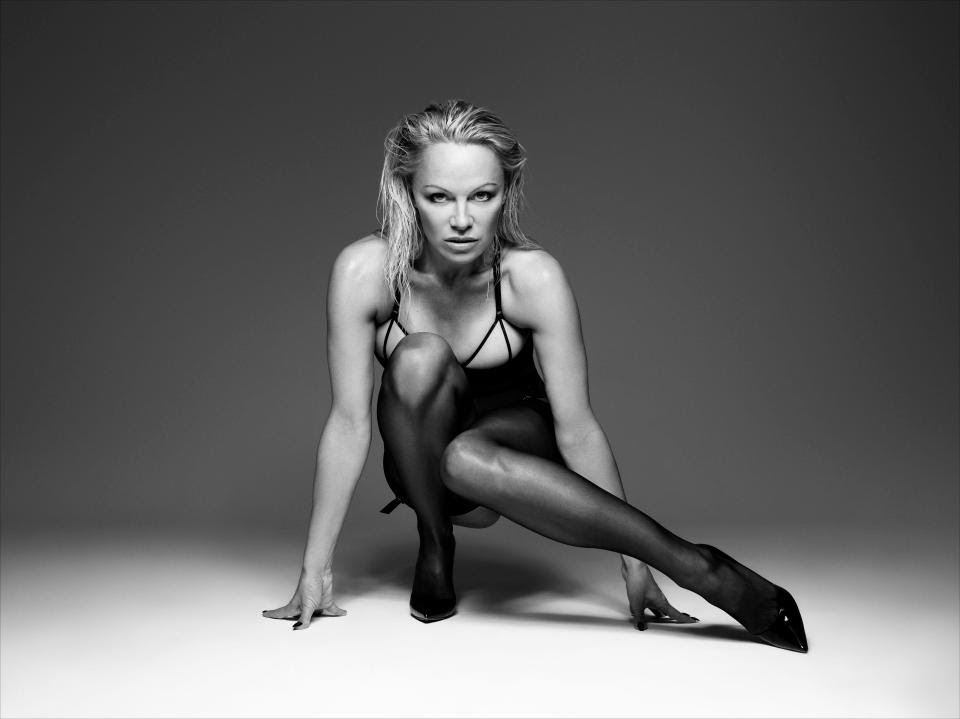 Pamela Anderson Posing For Bondage-Inspired Lingerie Photoshoot