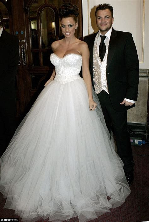 Katie Price is back in a wedding dress as she glams it up