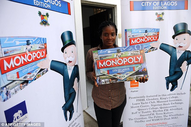 All go in Nigeria: Promoter Fiona Donald holds a Lagos edition of Monopoly at the launch of the first African city version of the game