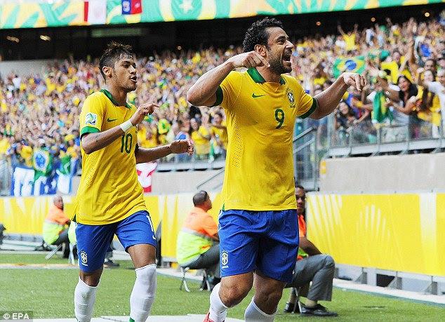 Delight: Fred celebrates his strike in front of the adoring fans in Belo Horizonte