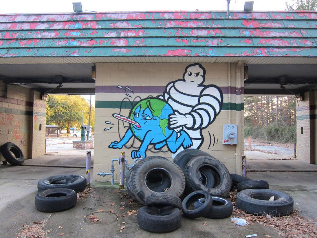 24 eloquentes obras de arte urbana mostrando a desagradável verdade 21