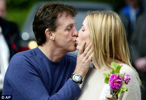 Happier times: Sir Paul and Heather Mills announce their engagement in 2002