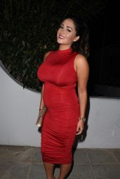 Casey Batchelor Shows off her pregnancy body in a red dress in Cyprus