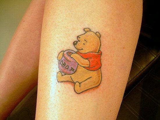 Winnie The Pooh Cartoon Tattoo On Back Leg