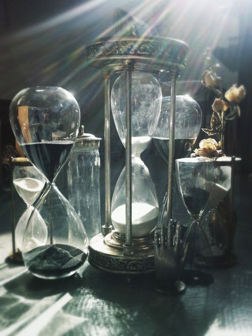 """You are a collector?"" she asked, examining each hourglass. Some were gold, brass, silver, ivory even. They had different-colored sands in each. He replied, ""As I said to you, I keep track of my favors. These contain the remaining times of those who owe debts to me...which they are paying back with time spent in my service."""