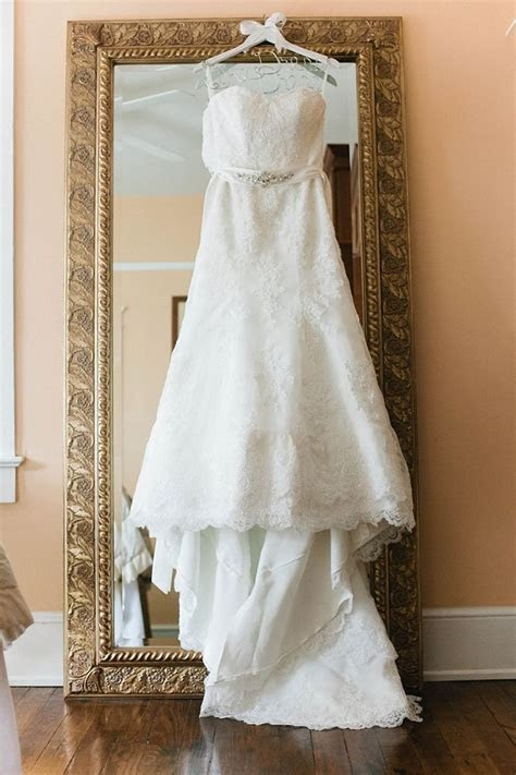 wedding dress hanging up on a mirror   Wedding picture