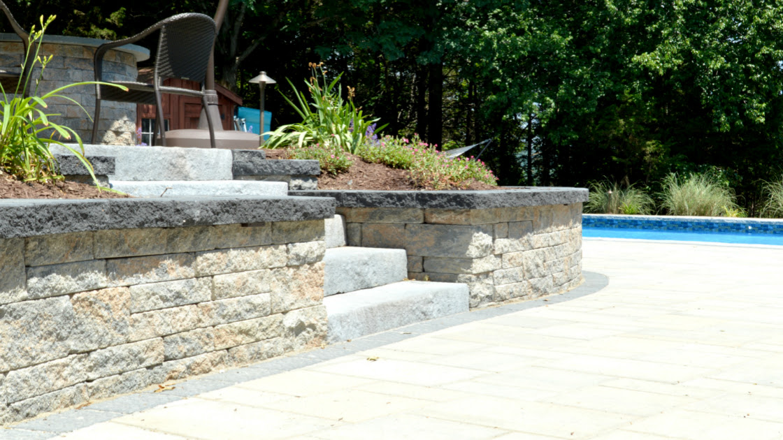 Retaining Wall Options Natural Stone Concrete Veneer Or Painted