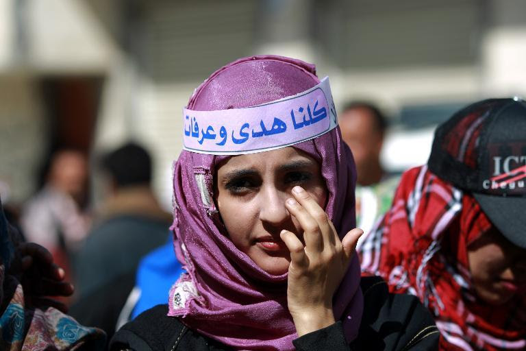 A Yemeni girl takes part in a gathering in support with Saudi woman Huda al-Niran outside a courthouse in Sanaa, on November 24, 2013