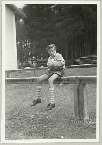 Boy holding a Chicken