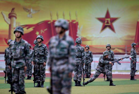 Chinese cadets taking part in a bayonet drill on the outskirts of Beijing. Mindful of past defeats, President Xi Jinping has embarked on an ambitious program to overhaul the military.