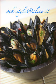 Sea - Mussels Sautéed in a Wooden Bowl