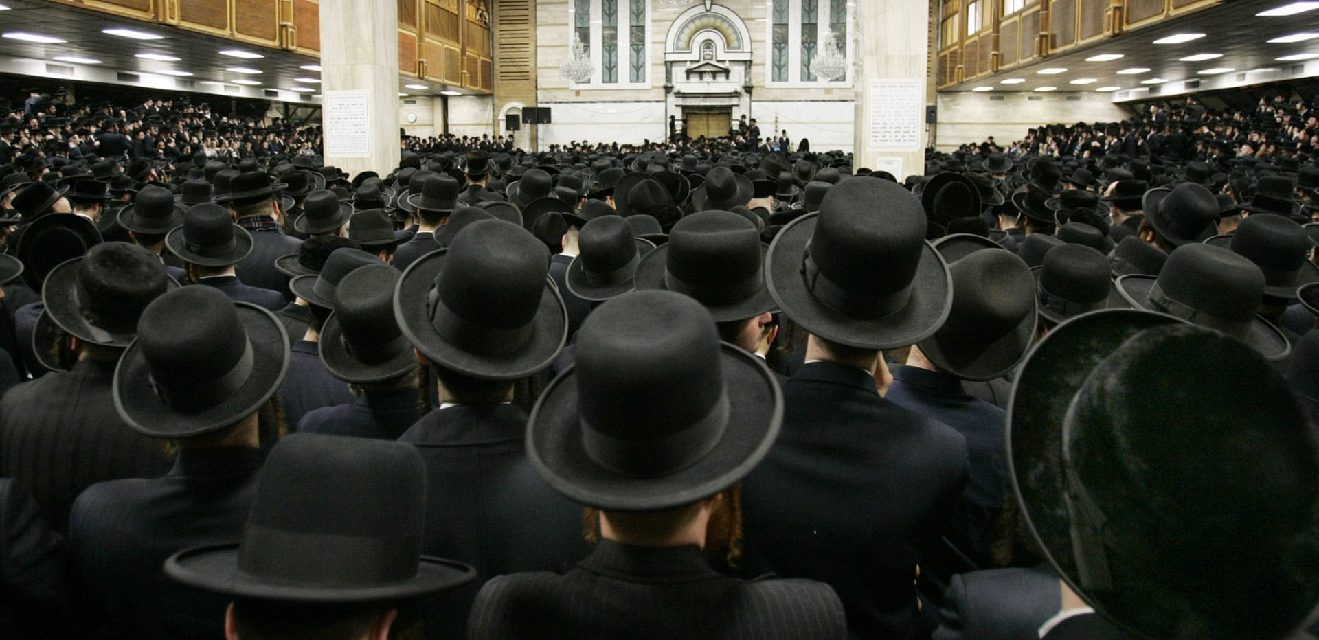Followers of ultra-Orthodox Jewish Rabbi Moses Teitelbaum of the Satmar Hassidim pack the Congregation Yetev Lev D'Satmar. Photograph: Mike Segar/Reuters