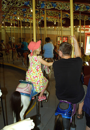 A father and his daughter enjoy a ride on the Port Dalhousie Carousel