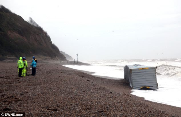 A container, lost from a vessel in the Bay of Biscay, carrying thousands of cigarettes has washed up on the pebble beach of Seaton in Devon