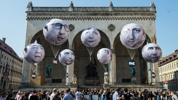 MUNICH, GERMANY - JUNE 05: Activists have installed balloons decorated with the portraits of (L-R) Japanese Prime Minister Shinzo Abe, French President Francois Hollande, Italian Prime Minister Matteo Renzi, German Chancellor Angela Merkel, Canadian Prime Minister Stephen Harper, British Prime Minister David Cameron and US President Barack Obama during a protest activity against the G7 summit on June 5, 2015 in Munich, Germany. Germany will host the G7 summit at Elmau Castle near Garmisch Partenkirchen, southern Germany, on June 7 and June 8, 2015. (Photo by Joerg Koch/Getty Images)