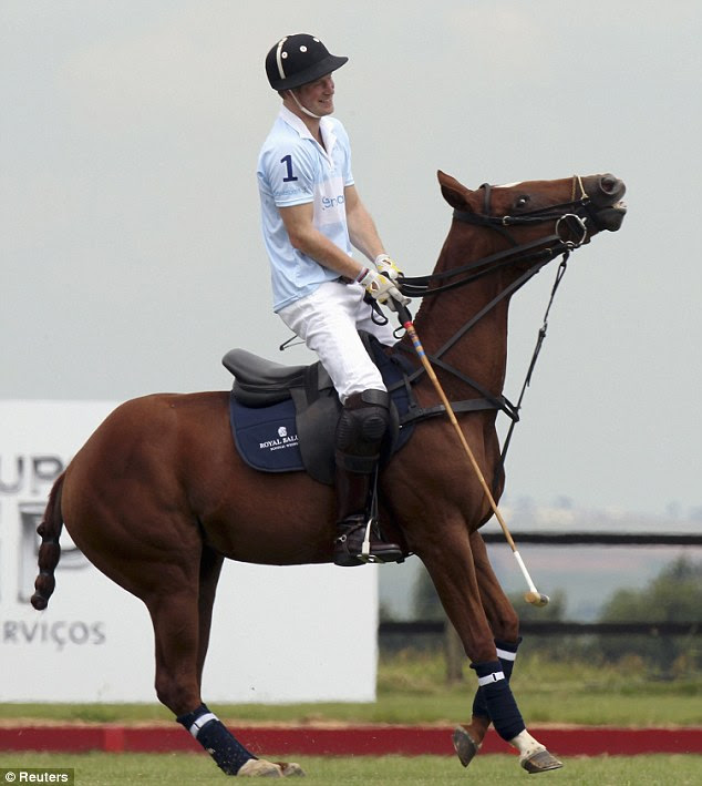 Sporty: Prince Harry warms up before a charity polo match in Brazil as part of the Queen's jubilee celebrations