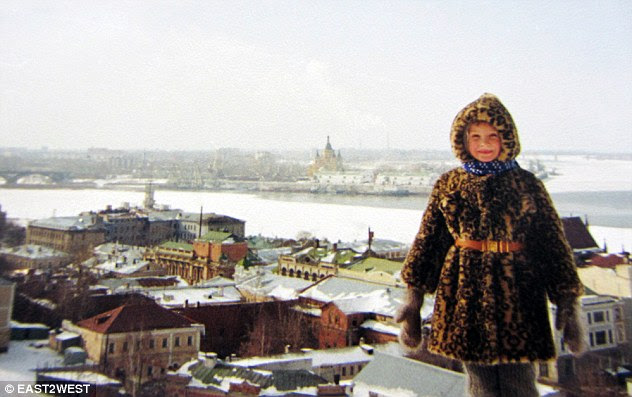 Much-loved: Olga Chardymova aged five in the old part of Nizhny Novgorod, in central Russia