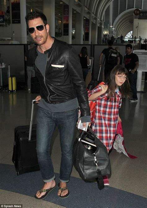 Dylan McDermott flaunts his looks as he arrives at LAX