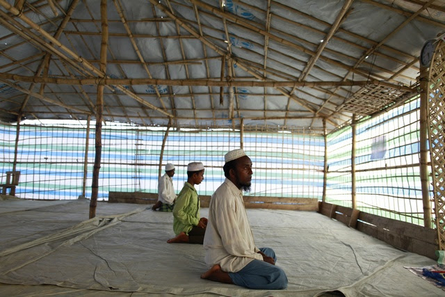 In this file picture from May, Muslim men offer Friday prayers in a makeshift mosque in Sittwe, Arakan state. (Reuters)