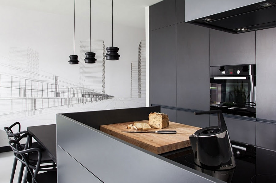 Sleek, minimal kitchen island in grey and black with kitchen shelves in gray in the backdrop