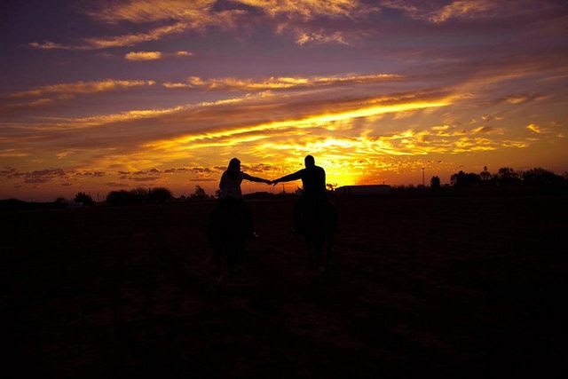 Riding into the sunset. Photo Credit: Haley Boatright. JC Photography. Horse engagement pictures, engagement pictures, sunset pictures, horse pictures, couples pictures.