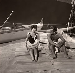 Robert Conrad and Myrna Fahey on a soundstage beach, Hawaiian Eye, 1963