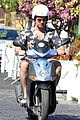 gerard butler suits up in ischia rides scooter around town 05