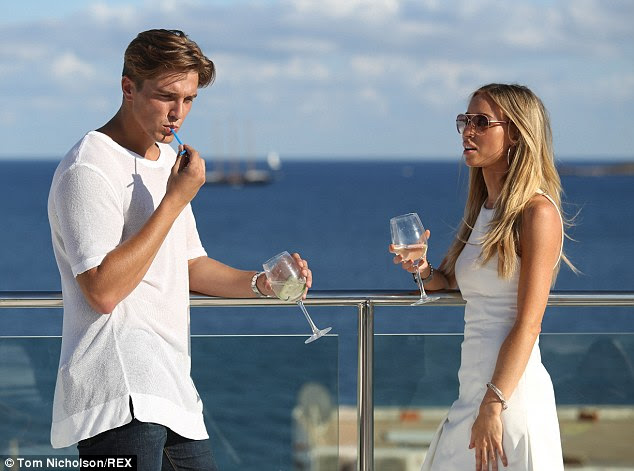 Not best pleased: TV personality Lauren rounds on her boyfriend during an exchange outside Ibiza Town's hotel Es Vive on Tuesday