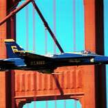 A U.S. Navy Blue Angels F-18 jet, piloted by Lt. Cmdr. Scott Ind, flies near the south tower of the Golden Gate Bridge, Thursday, Oct. 7, 1999, in San Francisco.