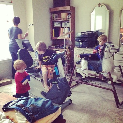 "The boys getting on their ""motorcycles"" (the horse and exercise bike)"