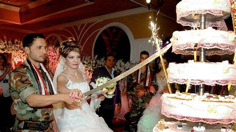 Syrian regime holds group wedding for 'hero' soldiers
