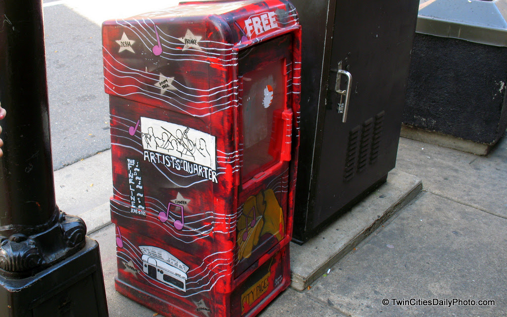 It was empty when I photographed it, but this hand painted newspaper box sits outside the First Avenue night club.