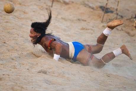 Enawene Nawe man playing head-football.